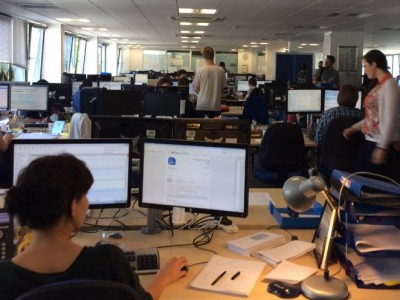people working in the office at Here