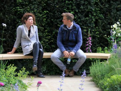 A man and a woman talking sitting on a bench
